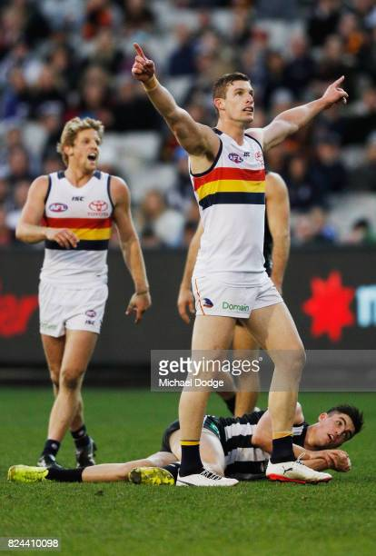 Josh Jenkins of the Crows celebrates a goal above Brayden Maynard of the Magpies during the round 19 AFL match between the Collingwood Magpies and...