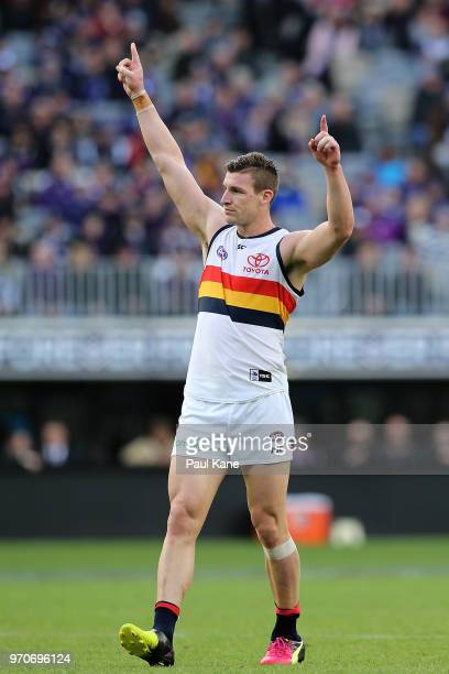 Josh Jenkins of the Crows celebrates a goal during the round 12 AFL match between the Fremantle Dockers and the Adelaide Crows at Optus Stadium on...