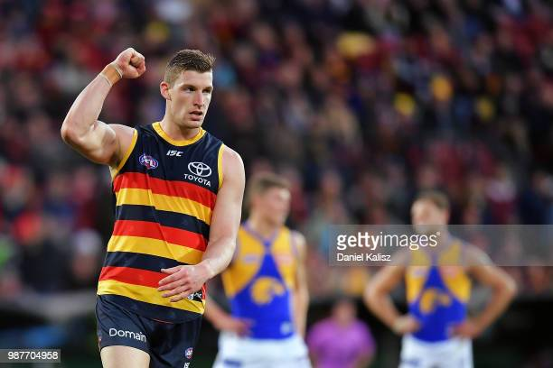 Josh Jenkins of the Crows celebrates after kicking a goal during the round 15 AFL match between the Adelaide Crows and the West Coast Eagles at...