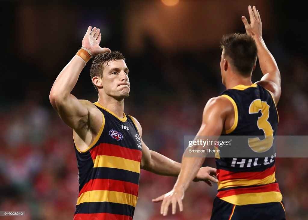 Josh Jenkins of the Crows celebrates kicking a goal with team mate Riley Knight during the round five AFL match between the Sydney Swans and the Adelaide Crows at Sydney Cricket Ground on April 20, 2018 in Sydney, Australia.