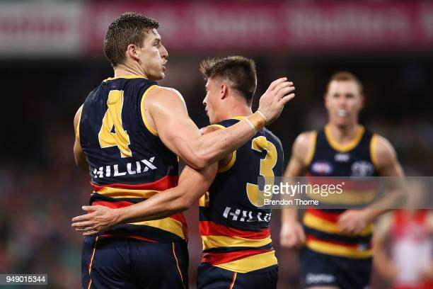 Josh Jenkins of the Crows celebrates kicking a goal with team mate Riley Knight during the round five AFL match between the Sydney Swans and the...