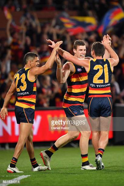 Josh Jenkins of the Crows celebrates with Rory Atkins and Charlie Cameron of the Crows during the First AFL Preliminary Final match between the...