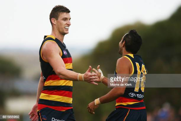 Josh Jenkins of the Crows celebrates with teammate Eddie Betts after Jenkins kicked his fifth goal during the JLT Community Series AFL match between...