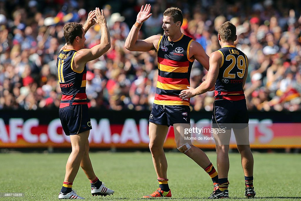 Josh Jenkins (C) of the Crows celebrates with teammates after he kicked a goal during the round five AFL match between the Adelaide Crows and the Greater Western Sydney Giants at Adelaide Oval on April 20, 2014 in Adelaide, Australia.