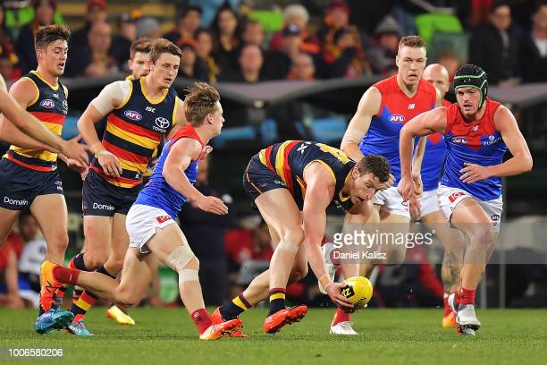 Josh Jenkins of the Crows competes for the ball during the round 19 AFL match between the Adelaide Crows and the Melbourne Demons at Adelaide Oval on...