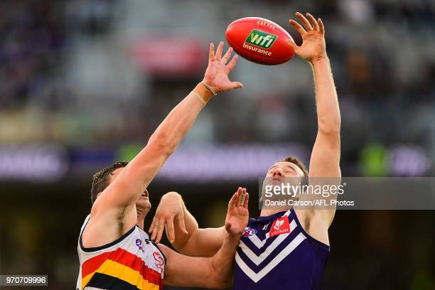 Josh Jenkins of the Crows contests a boundary throw in against Michael Apeness of the Dockers during the 2018 AFL round 12 match between the...