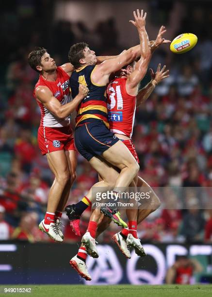 Josh Jenkins of the Crows contests the ball with the Swans defence during the round five AFL match between the Sydney Swans and the Adelaide Crows at...