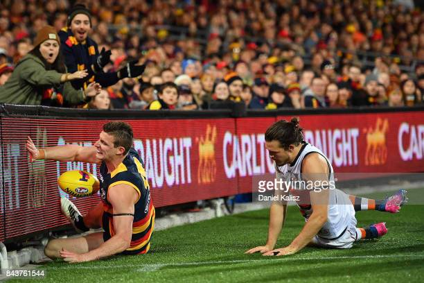 Josh Jenkins of the Crows crashes into the boundary fence during the AFL First Qualifying Final match between the Adelaide Crows and the Greater...