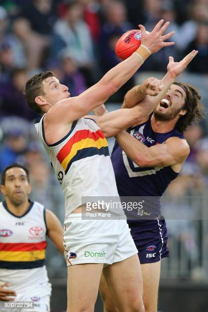 Josh Jenkins of the Crows has his mark spolied by Alex Pearce of the Dockers during the round 12 AFL match between the Fremantle Dockers and the...