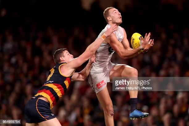 Josh Jenkins of the Crows is out marked by Harry McKay of the Blues during the 2018 AFL round seven match between the Adelaide Crows and the Carlton...