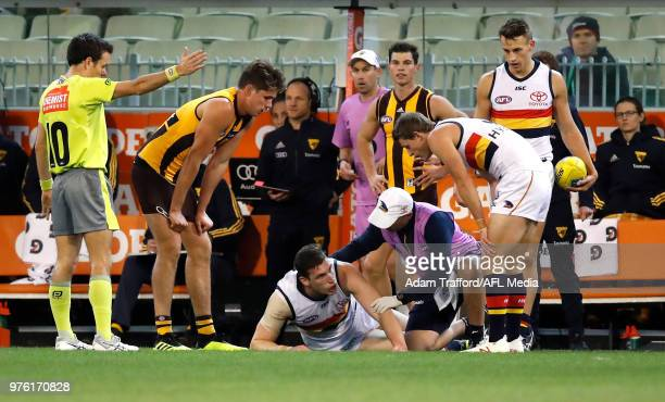 Josh Jenkins of the Crows is seen recovering after hitting his head on the ground during the 2018 AFL round 13 match between the Hawthorn Hawks and...