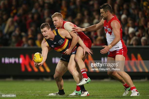 Josh Jenkins of the Crows is tackled by Dan Hannebery of the Swans during the 2017 AFL round 22 match between the Adelaide Crows and the Sydney Swans...