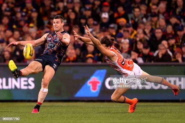 Josh Jenkins of the Crows is tackled by Phil Davis of the Giants during the 2018 AFL round 11 match between the Adelaide Crows and the GWS Giants at...