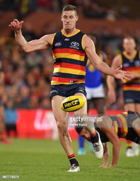 Josh Jenkins of the Crows kicks the ball during the round 15 AFL match between the Adelaide Crows and the West Coast Eagles at Adelaide Oval on June...