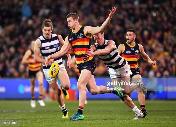 Josh Jenkins of the Crows kicks the ball during the round 17 AFL match between the Adelaide Crows and the Geelong Cats at Adelaide Oval on July 12...