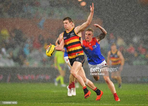 Josh Jenkins of the Crows kicks the ball during the round 19 AFL match between the Adelaide Crows and the Melbourne Demons at Adelaide Oval on July...