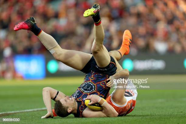 Josh Jenkins of the Crows marks in front of Phil Davis of the Giants during the 2018 AFL round 11 match between the Adelaide Crows and the GWS Giants...