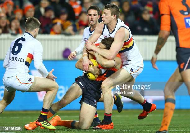 Josh Jenkins of the Crows tackles during the round 21 AFL match between the Greater Western Giants and the Adelaide Crows at UNSW Canberra Oval on...