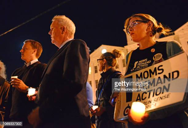 Josh Johnson DC Councilman Tommy Wells Kelsey Lyle and Jocelyn Strauss participate in an interfaith candlelight vigil for victims of the Navy Yard...