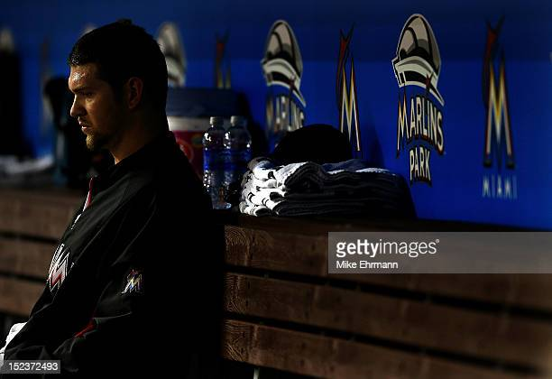 Josh Johnson of the Miami Marlins waits in the dugout during a game against the Atlanta Braves at Marlins Park on September 19 2012 in Miami Florida