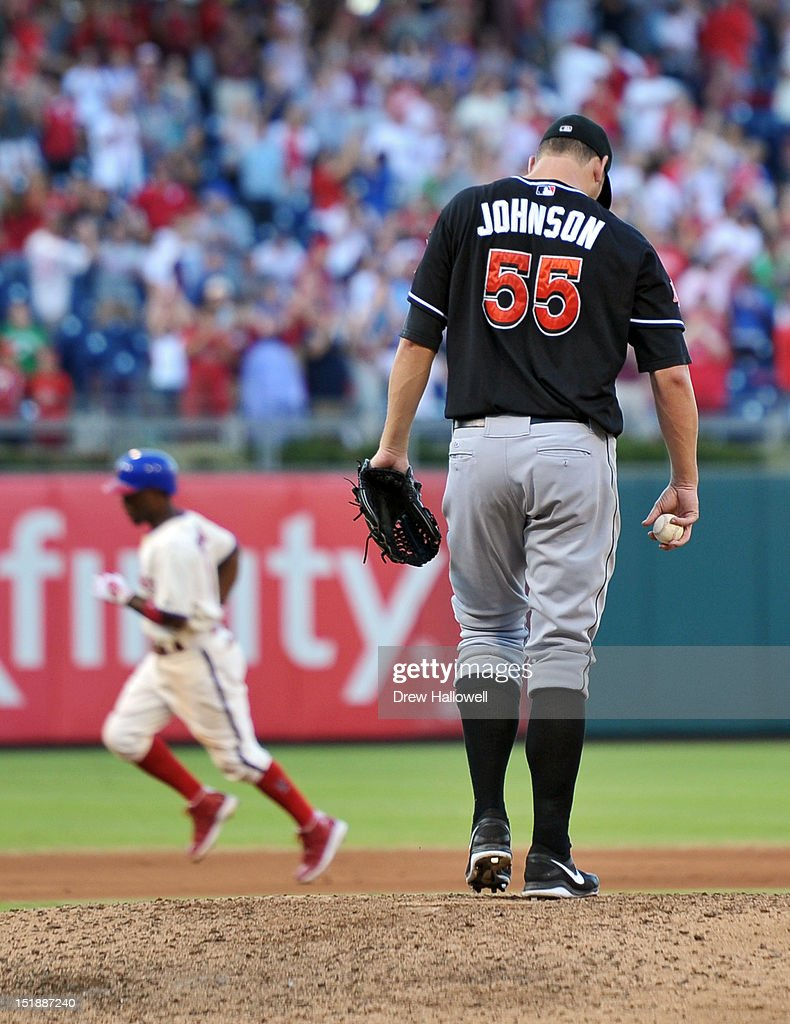 Josh Johnson #55 of the Miami Marlins walks back to the mound after giving up a two-run home run to Jimmy Rollins #11 of the Philadelphia Phillies at Citizens Bank Park on September 12, 2012 in Philadelphia, Pennsylvania. The Phillies won 3-1.