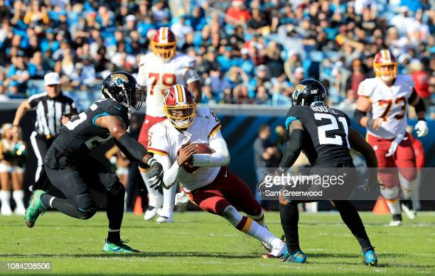 Josh Johnson of the Washington Redskins is tackled by D.J. Hayden of the Jacksonville Jaguars during the game at TIAA Bank Field on December 16, 2018...