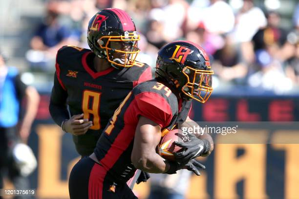 Josh Johnson of the LA Wildcats hands off the ball to Elijah Hood during first quarter action against the Dallas Renegades at Dignity Health Sports...