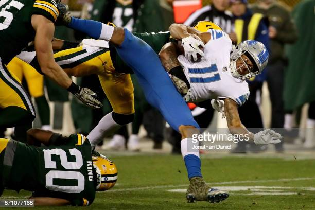 Josh Jones of the Green Bay Packers tackles Marvin Jones Jr #11 of the Detroit Lions in the fourth quarter at Lambeau Field on November 6 2017 in...