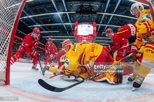 Josh Jooris of Lausanne HC tries to score against Goalie Jonas Hiller of EHC Biel during the Swiss National League game between Lausanne HC and EHC...