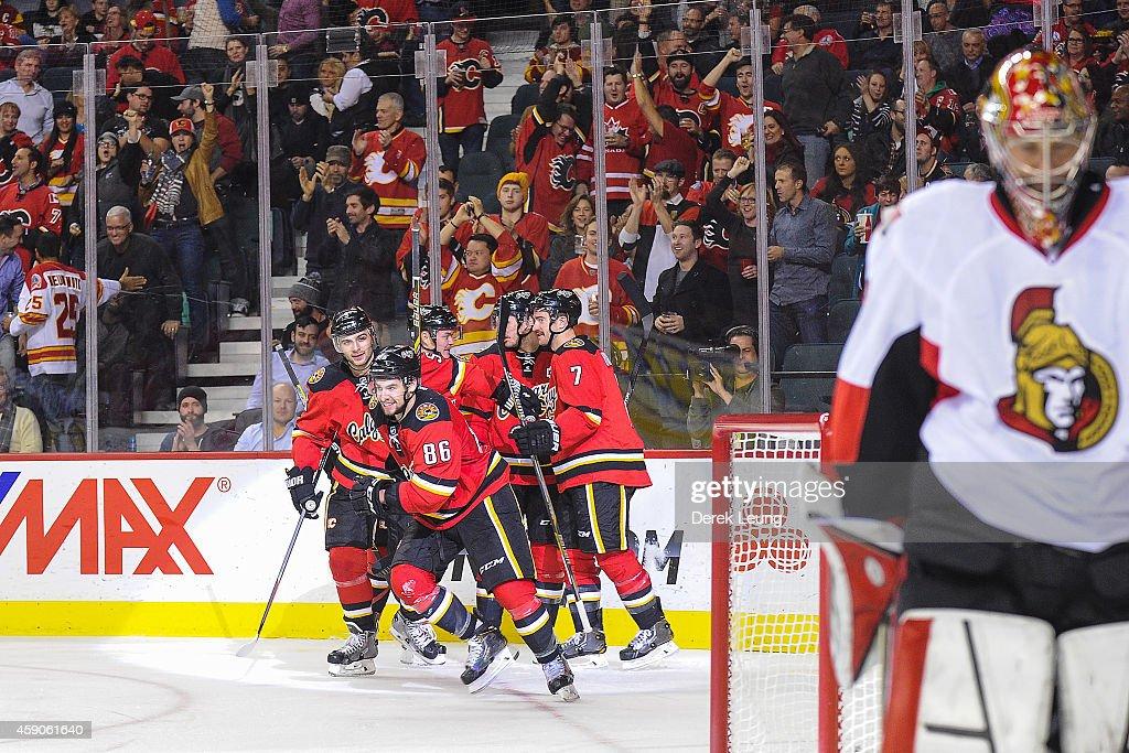 Josh Jooris #86 of the Calgary Flames celebrates a power play goal against Craig Anderson #41 of the Ottawa Senators during an NHL game at Scotiabank Saddledome on November 15, 2014 in Calgary, Alberta, Canada. The Flames defeated the Senators 4-2.