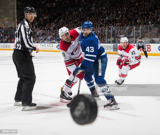 Josh Jooris of the Carolina Hurricanes and Nazem Kadri of the Toronto Maple Leafs battle for the puck during the second period at the Air Canada...