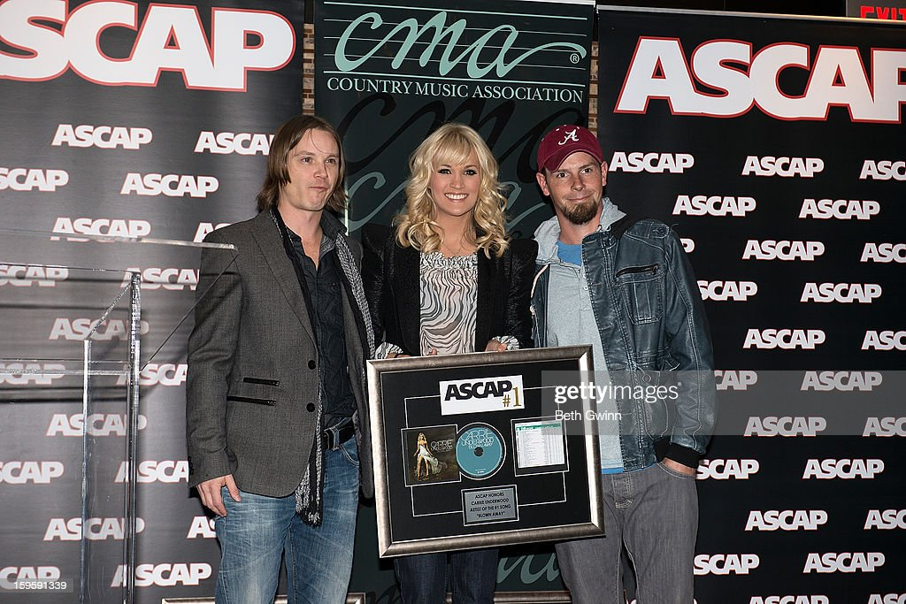 Josh Kear, Carrie Underwood, and Chirs Tompkins attends the Blown Away #1 Party at ASCAP Building on January 16, 2013 in Nashville, Tennessee.