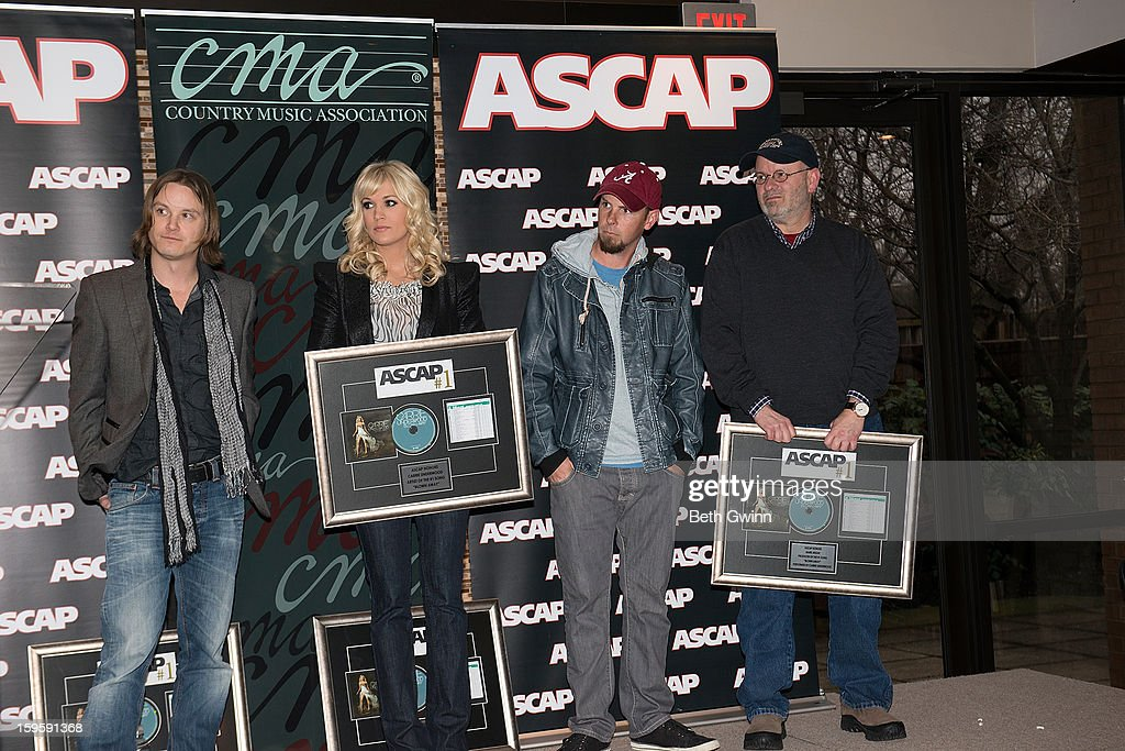 Josh Kear, Carrie Underwood, Chris Tompkins, and Mark Bright attends the Blown Away #1 Party at ASCAP Building on January 16, 2013 in Nashville, Tennessee.