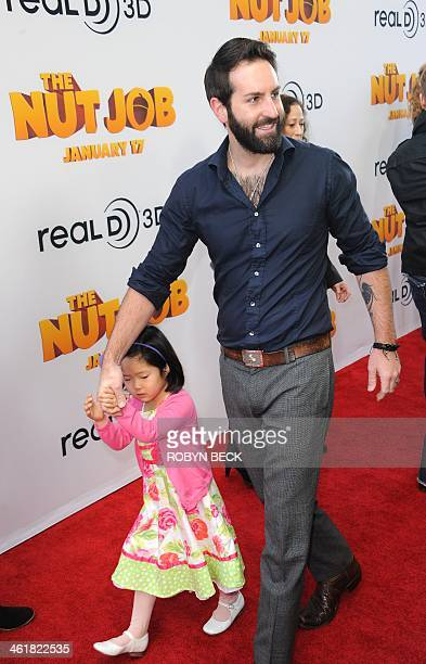 Josh Kelley and daughter Nancy 'Naleigh' Leigh arrive for the Los Angeles premiere of The Nut Job on January 11 2014 at the Regal Cinema LA Live in...
