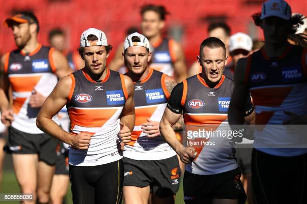 Josh Kelly Daniel Lloyd and Tom Scully of the Giants train during a Greater Western Sydney Giants AFL training session at Spotless Stadium on July 5...