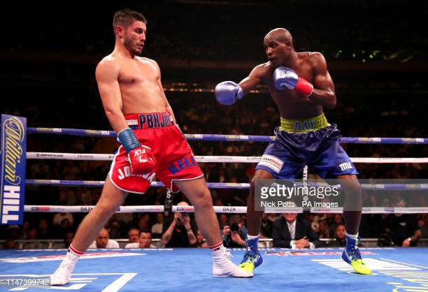 Josh Kelly in action against Ray Robinson in the WBA International Welterweight title fight at Madison Square Garden, New York.