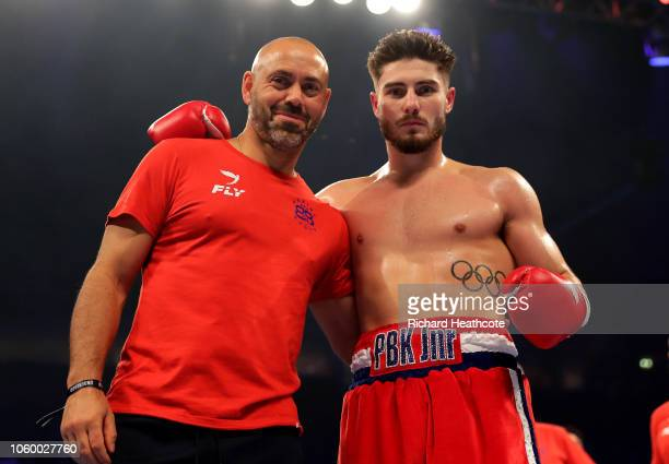 Josh Kelly of England celebrates victory with his trainer Adam Booth after the Welterweight Contest between Josh Kelly and Walter Fabian Castillo at...