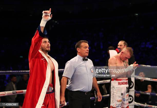 Josh Kelly of Great Britain celebrates victory over Przemyslaw Runowski of Poland during the WBA International Welterweight Championship during...