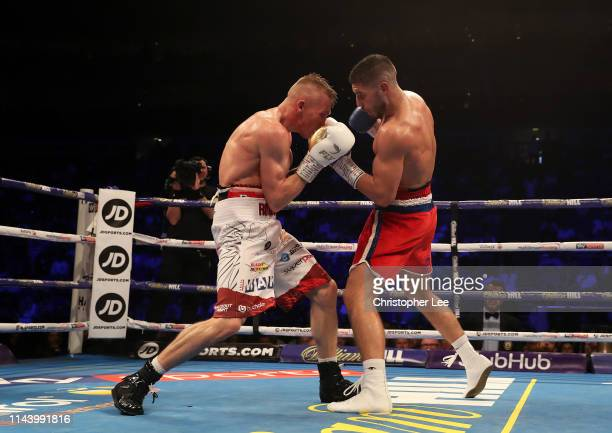 Josh Kelly of Great Britain in action with Przemyslaw Runowski of Poland during the WBA International Welterweight Championship during Boxing at The...