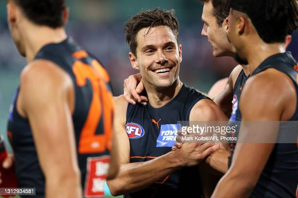 Josh Kelly of the Giants celebrates victory with his team mates during the round five AFL match between the Sydney Swans and the Greater Western...