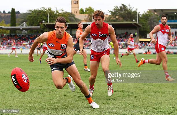 Josh Kelly of the Giants chases the ball during the NAB Challenge AFL match between the Greater Western Sydney Giants and the Sydney Swans at Star...