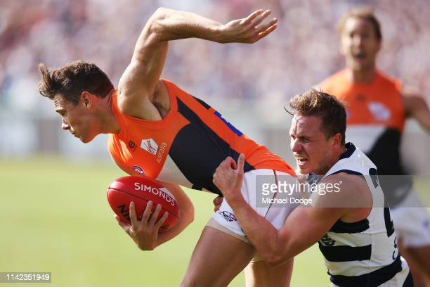 Josh Kelly of the Giants is tackled by Mitch Duncan of the Cats during the round four AFL match between the Geelong Cats and the Greater Western...