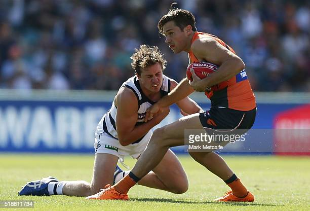 Josh Kelly of the Giants is tackled by Mitch Duncan of the Cats during the round two AFL match between the Greater Western Sydney Giants and the...