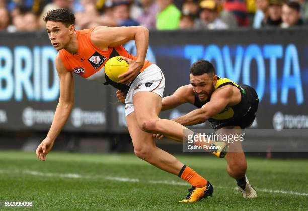 Josh Kelly of the Giants is tackled by Shane Edwards of the Tigers during the Second AFL Preliminary Final match between the Richmond Tigers and the...
