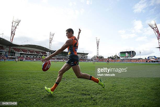 Josh Kelly of the Giants kicks the ball during the round 16 AFL match between the Greater Western Sydney Giants and the Collingwood Magpies at...