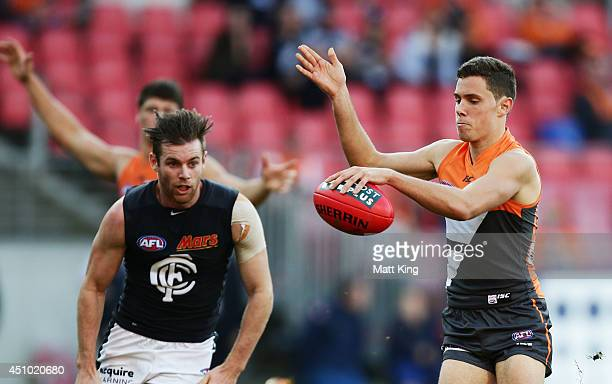 Josh Kelly of the Giants kicks upfield during the round 14 AFL match between the Greater Western Sydney Giants and the Carlton Blues at Spotless...