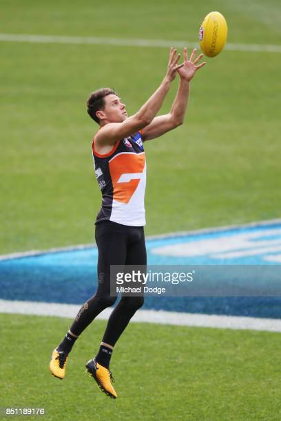 Josh Kelly of the Giants marks the ball during the Greater Western Sydney Giants AFL training session at Melbourne Cricket Ground on September 22...