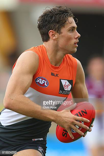Josh Kelly of the Giants runs the ball during the NAB Challenge AFL match between the Brisbane Lions and the Greater Western Sydney Giants at...
