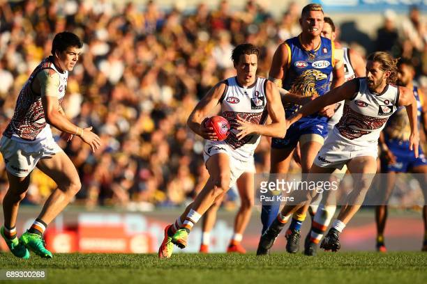 Josh Kelly of the Giants runs with the ball during the round 10 AFL match between the West Coast Eagles and the Greater Western Giants at Domain...