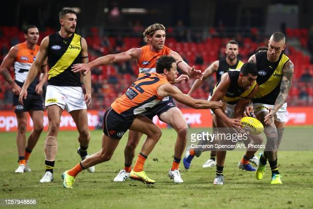 Josh Kelly of the Giants tackles Marlion Pickett of the Tigers during the round 8 AFL match between the Greater Western Sydney Giants and the...